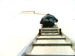 Person up ladder